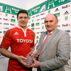 Heineken's Pat Maher is pictured presenting the man-of-the-match award to Munster flanker David Wallace