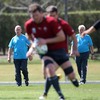 Coaches Declan Kidney and Alan Gaffney look on as Rugby World Cup debutant Donnacha Ryan carries the ball forward