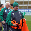 Ireland head coach Declan Kidney dishes out the bibs, with backs coach Alan Gaffney in the background. Kidney has overseen 19 Test wins to date during his coaching rein