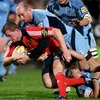 Munster full-back Denis Hurley is brought to ground by Cardiff winger and former Wales captain Gareth Thomas