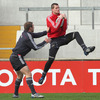 Denis Hurley rises above Johne Murphy to take a high ball during Tuesday's training run-out at Thomond Park
