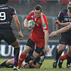Replacement Denis Hurley carries forward for Munster, with Mike Phillips and Tommy Bowe defending for the Welshmen