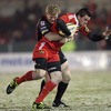 Munster winger Denis Hurley is closed down by the Dragons' Pat Leach during the opening minutes of Friday's game