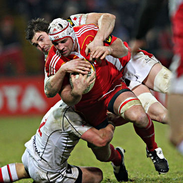 Denis Leamy is tackled by Rory Best and Ryan Caldwell