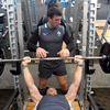 Jamie Heaslip gets through some bench press reps, with fellow back rower Denis Leamy spotting for him