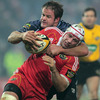 Munster stand-in captain Denis Leamy is caught in possession by his opposite number, Cardiff's Xavier Rush
