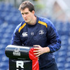 Lock Devin Toner assists with a tackle bag as the Leinster players go through their paces