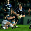 Leinster lock Devin Toner looks for support as Glasgow prop Moray Low brings him to ground