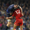Munster's powerhouse centre Sam Tuitupou and Leinster's long-limbed lock Devin Toner collide as the sides continue to slog it out