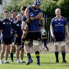 There is laughter all-round as giant lock Devin Toner attempts to lift Stan Wright during a training drill
