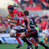 Scarlets lock Dominic Day barges his way through for a first half try, with Ulster's Paul Marshall close by