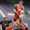 Munster lock Donnacha Ryan is supported by Wian du Preez and Mick O'Driscoll as he transfers a lineout ball