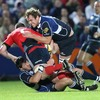Leinster's Shane Horgan and Rocky Elsom combine to halt the progress of Munster flanker Donnacha Ryan