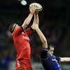 Munster lock Donnacha Ryan collects a lineout ball, under pressure from the 6ft 10in Devin Toner