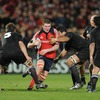 Munster lock Donnacha Ryan takes the ball into contact during the 30th anniversary match
