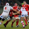Munster lock Donnacha Ryan takes the ball into contact, with Ulster's Tim Barker and Rory Best providing the opposition