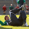Donncha O'Callaghan is shown going through some stretching exercises. The Corkman is just two games away from winning his 80th Ireland cap