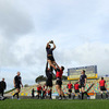 Ireland forwards coach Gert Smal looks on as Donncha O'Callaghan claims a lineout ball