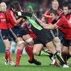 Donncha O'Callaghan battles to hold onto possession with Jerry Flannery close by