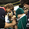 Donncha O'Callaghan signs a jersey for a young Ireland fan as others look on