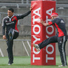All Black duo Doug Howlett and Sam Tuitupou warm up beside the posts at Thomond Park