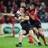 Munster winger Doug Howlett catches Glasgow's Bernardo Stortoni with a tackle in midfield