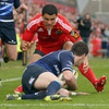 Jonathan Sexton tracked back to collect Doug Howlett's kick through, as Munster initiated a series of early attacks