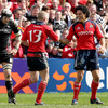 All Black Doug Howlett congratulates Keith Earls on scoring Munster's third touchdown against the Welsh region
