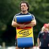 New Zealand winger Doug Howlett holds a tackle bag as Munster get through some contact work
