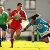 Winger Doug Howlett darts away from Toulon's Fotu Auelua during a memorable counter attack from Munster