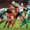 Former All Black winger Doug Howlett muscles his way forward as Munster take the game to their Italian visitors