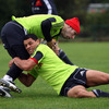 In-form winger Doug Howlett tackles Tomas O'Leary during Tuesday's rain-hit squad session