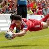 Munster winger Doug Howlett dives over for a second half try that was disallowed for a forward pass from Felix Jones