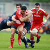 Leinster's Heinke van der Merwe and Nathan Hines double up on one of Munster's danger men, Doug Howlett