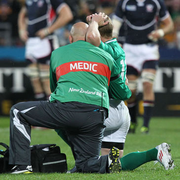 Dr Eanna Falvey treats Keith Earls for an injury