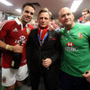 Conor Murray and Dr. Eanna Falvey flank rugby-loving actor Daniel Craig as they pose for a photograph