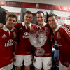Backs Leigh Halfpenny, Owen Farrell, Jonathan Sexton and Mike Phillips celebrate with the cup awarded to the series winners