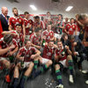 Tommy Bowe, Jamie Roberts and the rest of the players get soaked during the post-match celebrations in the dressing room