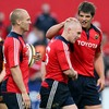 Hat-trick hero Keith Earls is congratulated by his Munster team-mates Paul Warwick and Donncha O'Callaghan