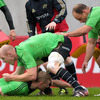 Forwards Paul O'Connell and BJ Botha combine at a ruck as Keith Earls, Ireland's top try scorer at the World Cup, lays the ball back