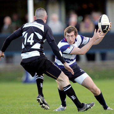 Blackrock winger Mark Scott-Lennon takes on Old Belvedere's Eddie Devitt