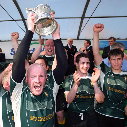 Boyne's Eddie Collins raises the Towns Cup aloft