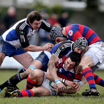 Clontarf's Eoin Cremen is caught in possession