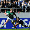 Ireland centre Eoin Griffin tries to fend off a French tackler in his side's Pool B opener