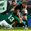 Connacht centre Eoin Griffin holds onto the ball under pressure from the Ireland Select XV's Darren Cave and Denis Hurley