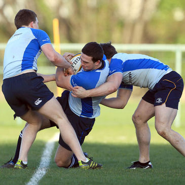 Eoin O'Malley is tackled by Andrew Conway and Isaac Boss