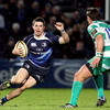 Eoin O'Malley tries to dance his way past Treviso's Willem de Waal, who missed a couple of early place-kicks