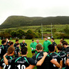 Connacht head coach Eric Elwood passes on some instructions to the players with Knocknarea Mountain in the background