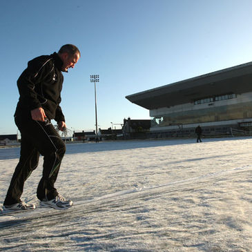 Eric Elwood assists the ground staff at the Sportsground