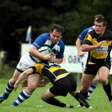 Dungannon centre Ethan Allen is tackled by Young Munster's Alan Kingsley